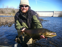 Asheville fly fishing guide Jake Chiles with a big brown trout