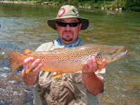 Jay Dodd holds a big brown trout